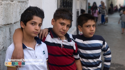 Shrivan, Amjad and Rajab hanging out in their neighborhood